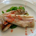 piatto a base di pesce di acqua dolce del lago di Vico